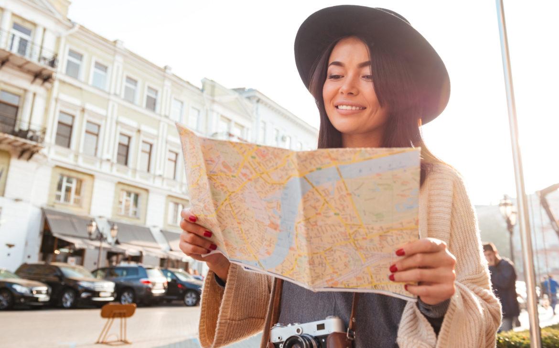 Portrait of a happy pretty woman tourist