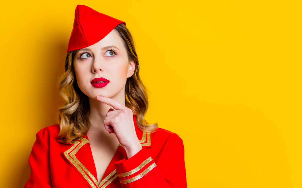 charming vintage stewardess wearing in red uniform